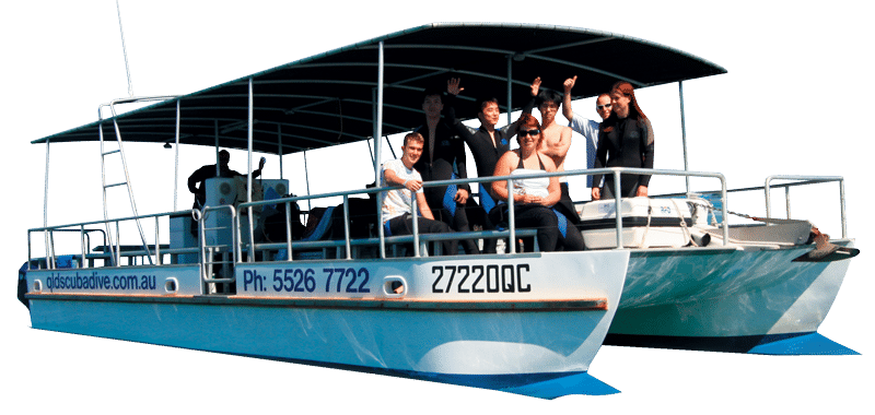 Scuba Diving boat with people onboard waving